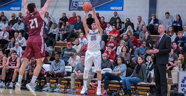 Matt Cardonne '18 launches a three-pointer versus Muhlenberg College in Johnston Hall during the first half in November 2017.