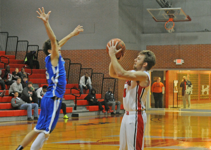 Alex Layson, shown here against Covenant, scored 19 points in Huntingdon's 86-62 loss to Maryville on Saturday. (Photo by Wesley Lyle)