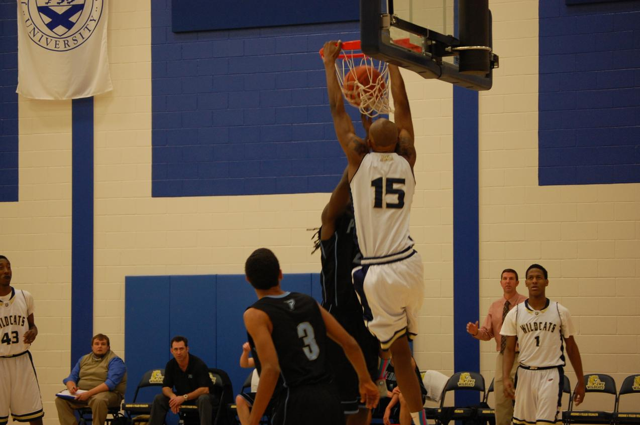 Mario Irby dunks against Piedmont International in Tuesday night's 85-73 win.