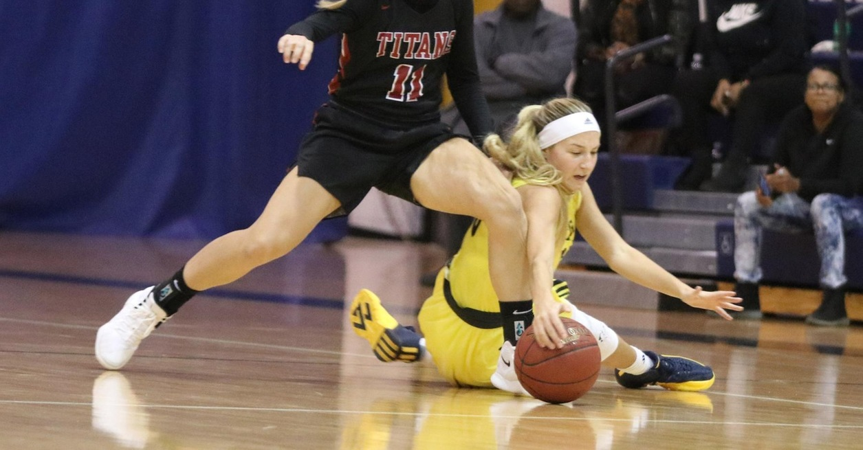 Titans rally to top Wolverines 64-63