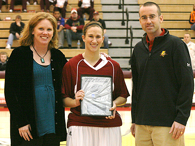 Junior Tricia Principe (center) is honored at a recent home game.  FSU will honor student-athletes for their academic success this Thursday (Photo Courtesy Zeke Jennings - Big Rapids Pioneer)