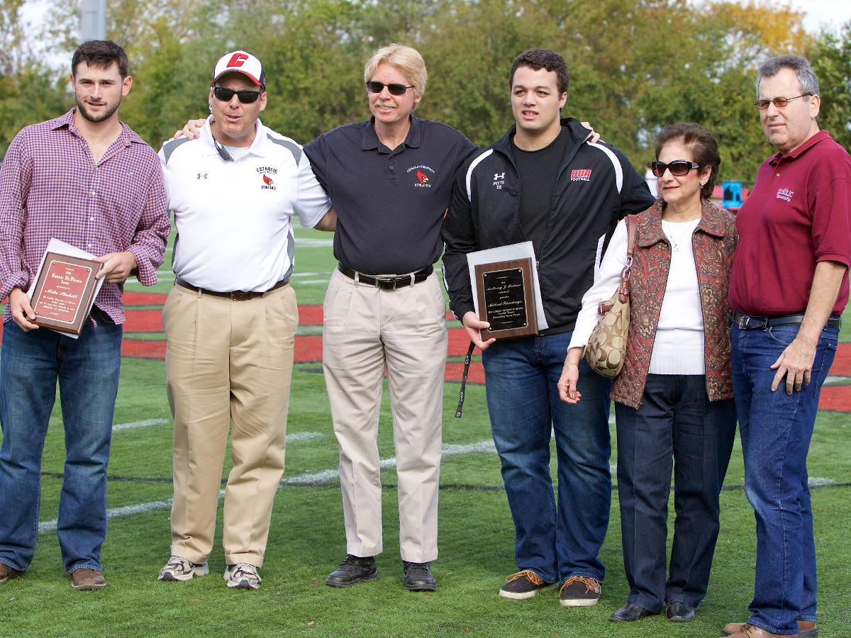 Former Football Players Pitsenberger, Skehill Receive Prestigious Awards