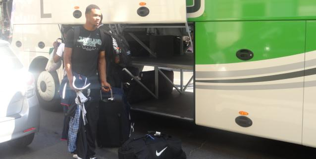 Demonte Flannigan unloads at the bus after arriving in Paris.