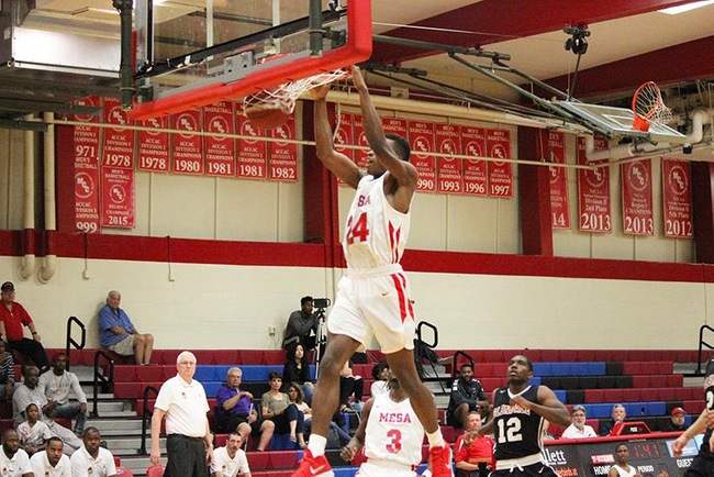 Errol Newman slams home two of his 24 points on the afternoon to lead Mesa over Glendale. (photo by Aaron Webster)