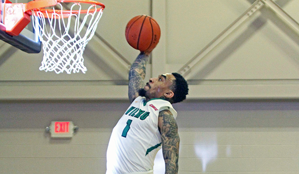 Copyright 2017; Wilmington University. All rights reserved. Photo of Tyaire Ponzo-Meek with a dunk against Nyack, taken by Frank Stallworth.