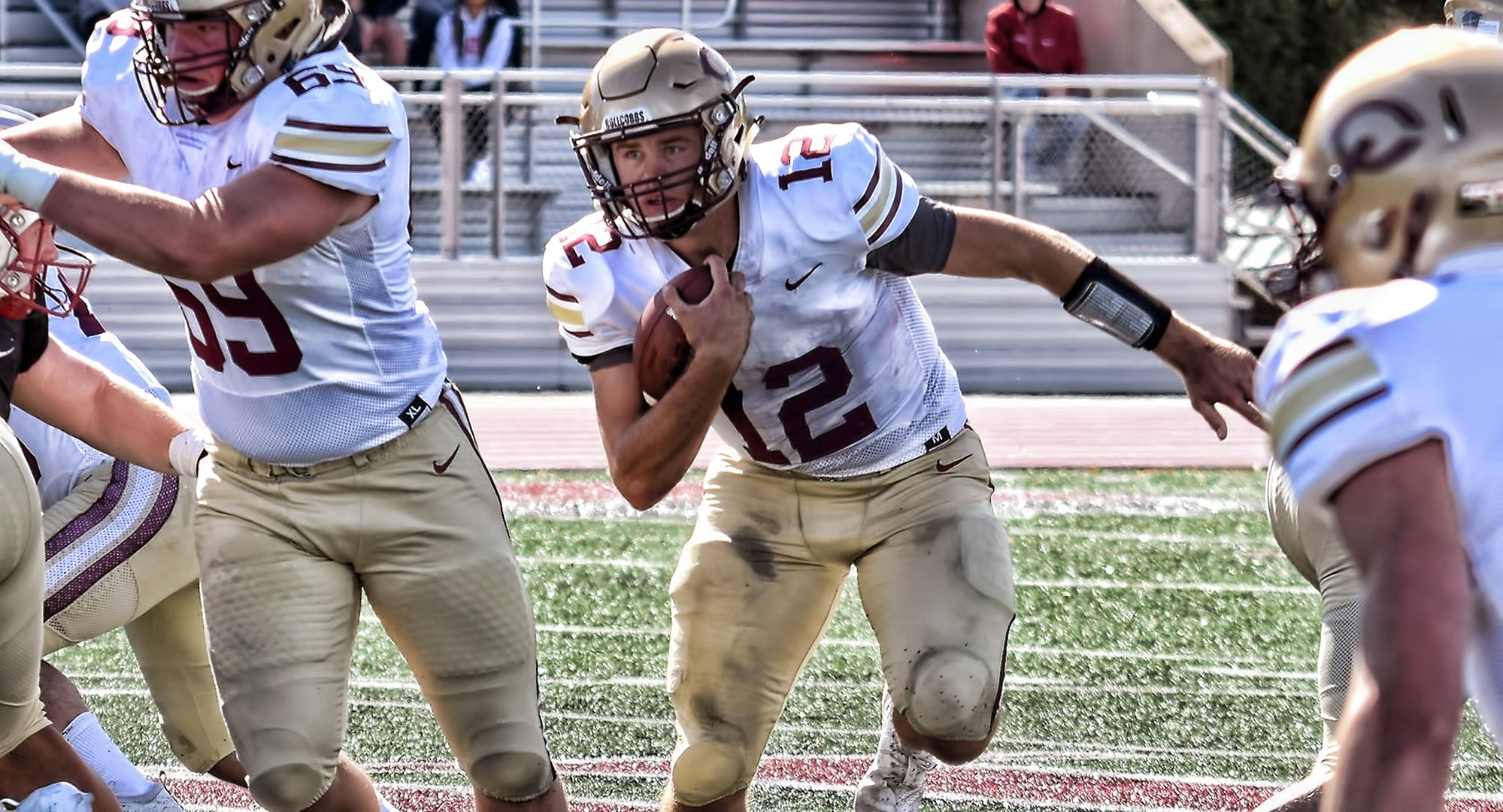 Senior quarterback Blake Kragnes breaks free for a big rushing gain during the Cobbers' win at Hamline. He finished with a season-high 101 yards on the ground.