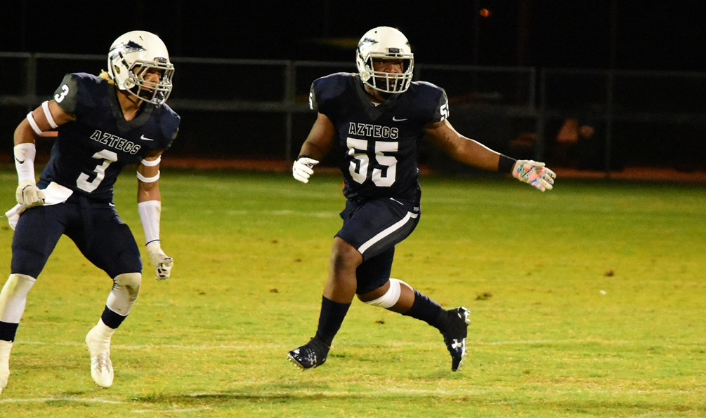 Aaron Maddox (#3) and Leon Huey (#55) helped lead the Pima defense to hold No. 2 ranked Arizona Western College to seven points in the second half but turnovers doomed the Aztecs in their 28-23 loss in Yuma. Pima is now 2-6 overall. Photo by Ben Carbajal.
