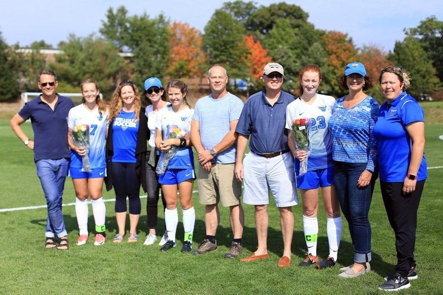 Seniors (L to R) Zoe Matticks, Melise Knowles, and Gen Crotty celebrated Senior Day with their families prior to today's game (Photo by Lauren Luo).