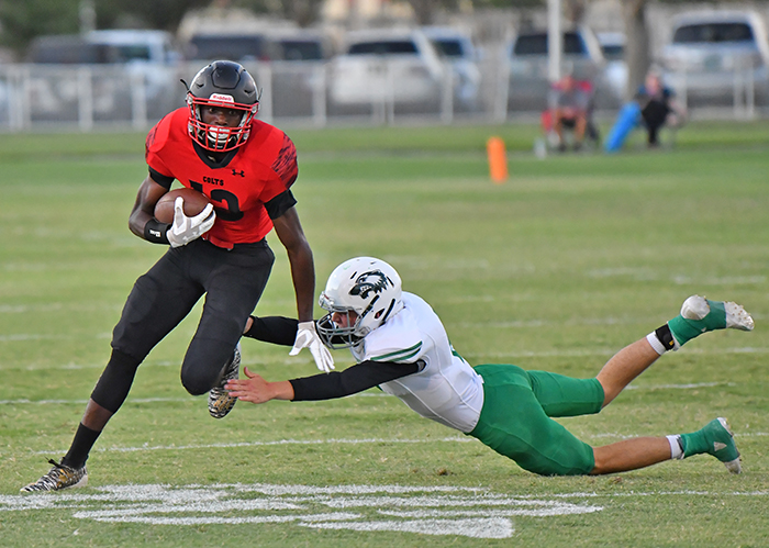 NMMI's Elijah Evans with a punt return in the first half against Texico. He had three returns for 85 yards. Photo by cadet Christopher Mumba.