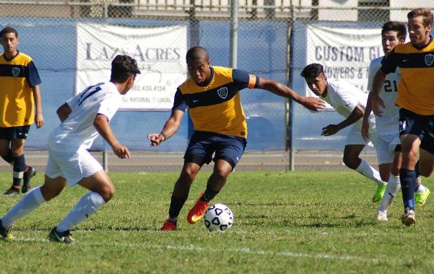 Aaren Lewis dribbles around an IVC defender in the Chargers 3-2 win.