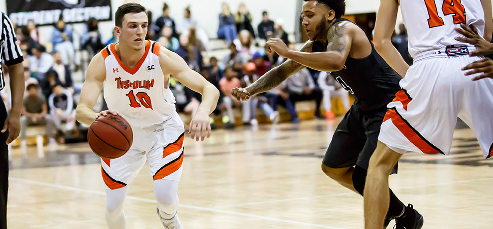 Woods scores career-high 31 in Tusculum's 97-71 win over Mars Hill