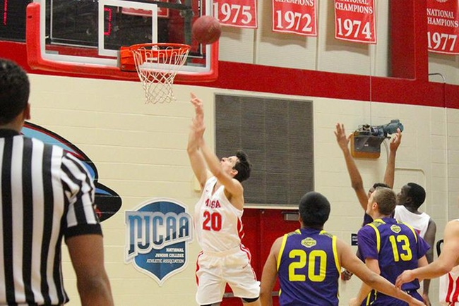 Bryce Cheney (#20) power's up a layup two of his 17 points Wednesday night against Tohono O'Odham.