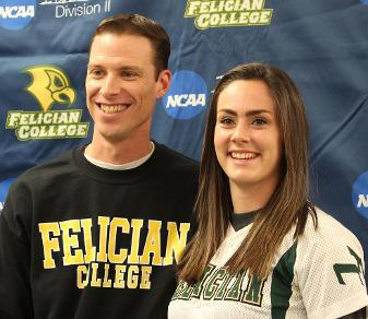 Felician College head softball coach Chris Foye poses with 2014 early signee Kaila Gerber at Felician's early signee reception on Friday.