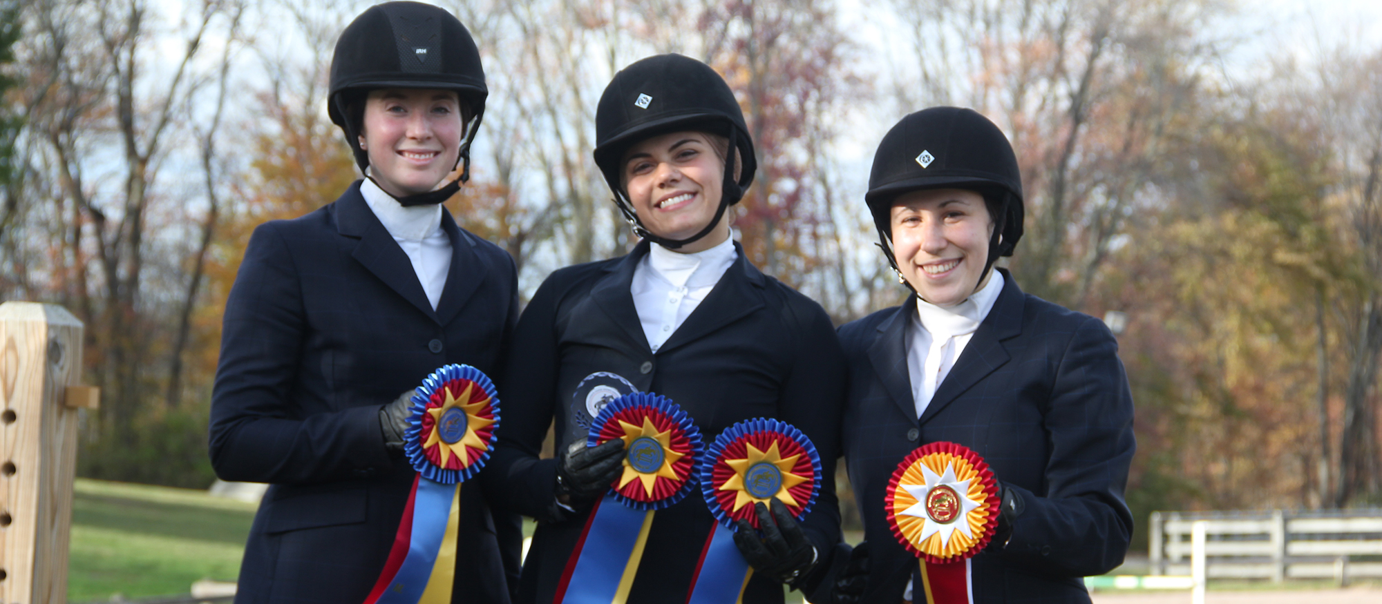 Photo featuring Lyons riders (from left to right): Anna Rzchowski, Libby Sams and Kaziah Brachfeld, who all earned individual honors at the October 28 home show at the MHC Equestrian Center.