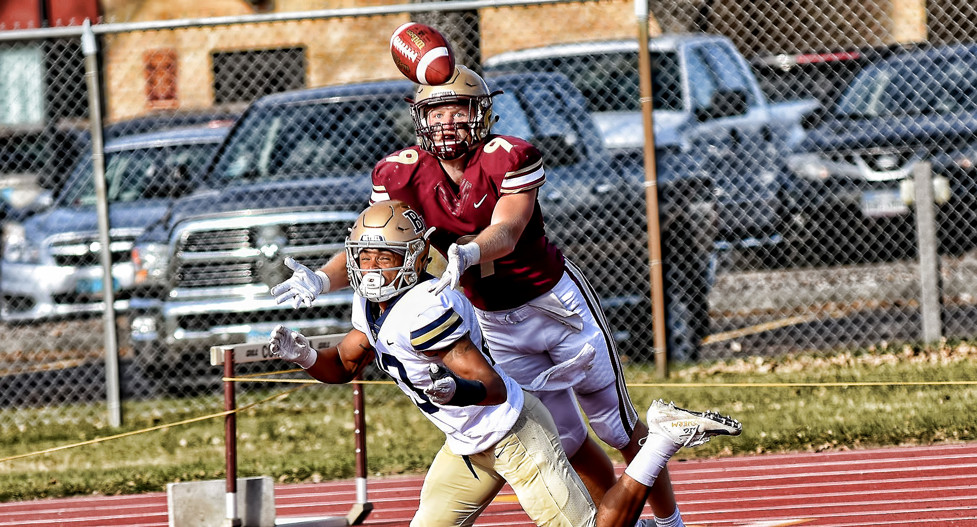 Senior Matt Bye goes over a Bethel defender to try and make a catch during the Cobbers' game with the Royals.