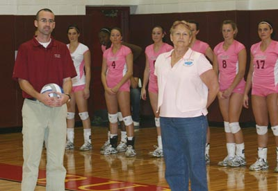 FSU Associate Athletics Director Jon Coles and the fans pay tribute to breast cancer surviror Terri Bloomquist before the match. (Photo by Sandy Gholston)