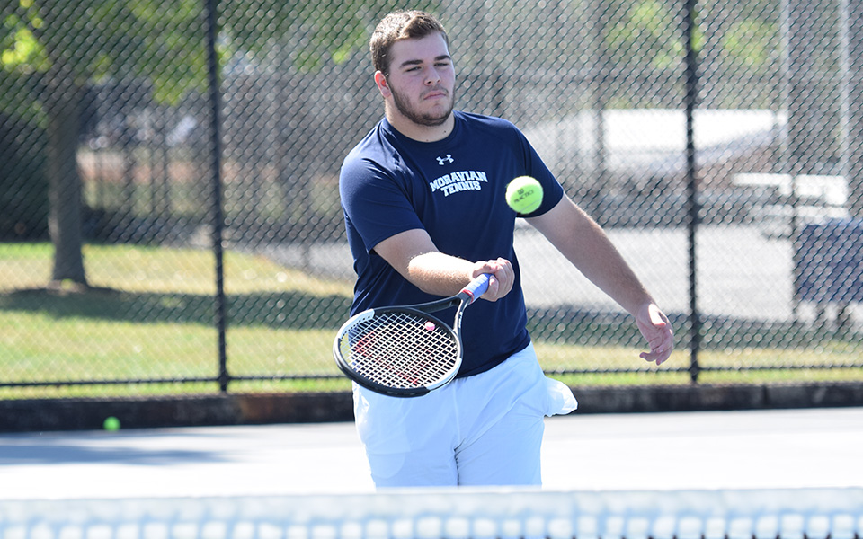 Kieran Pisani hits a volley at the net versus Misericordia University at Hoffman Courts.
