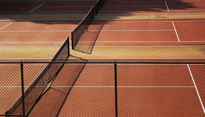 tennis courts with gold and crimson paint