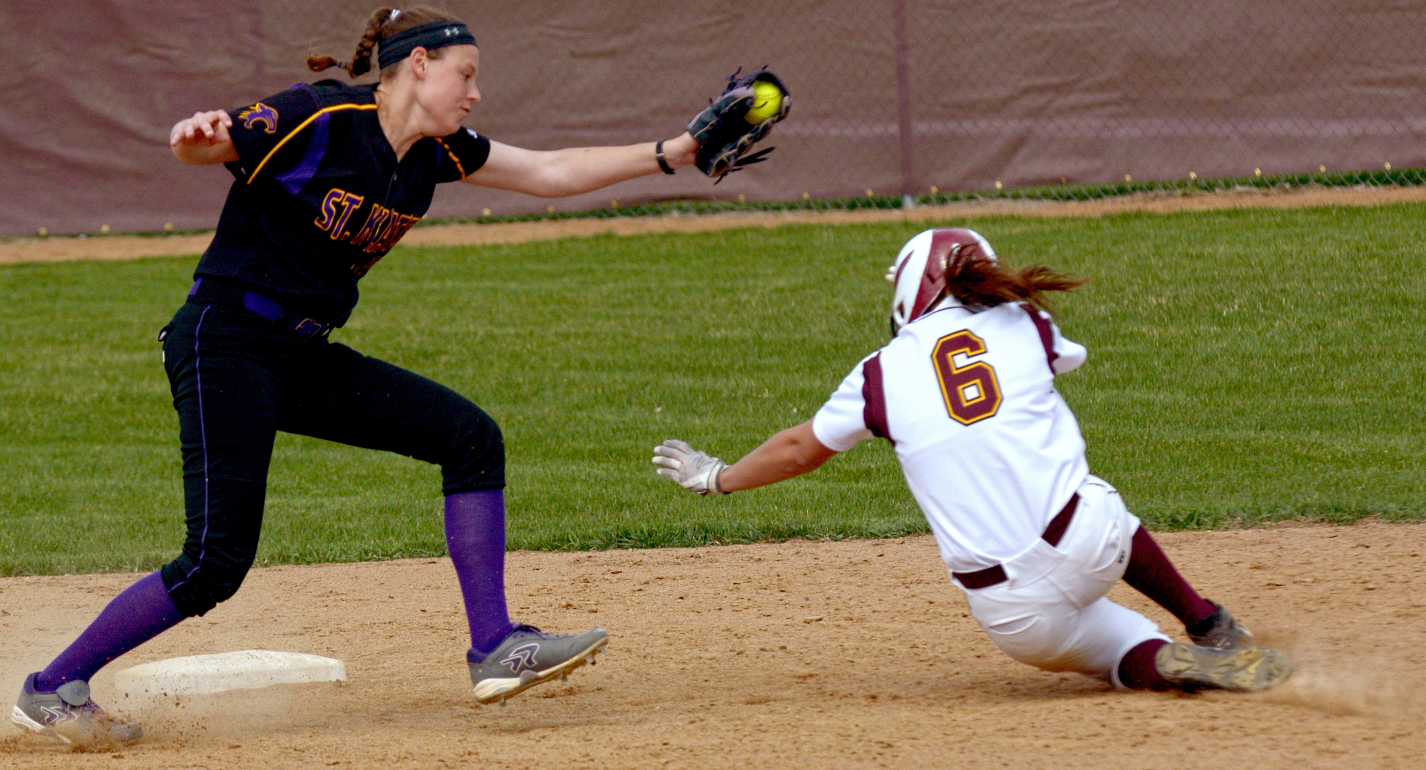 Senior Madison Little slides under the tag for her single-season record-breaking 25th stolen base during the Cobbers' DH with St. Catherine.