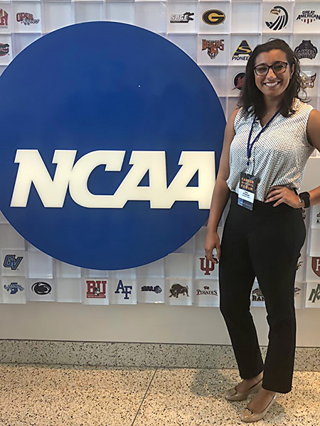 Kiera O'Donnell posing in from of ncaa logo