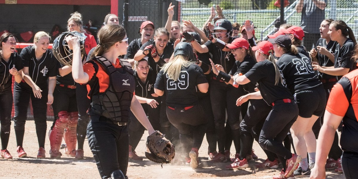 Cardinals celebrate Lindsey Pyle's walk-off home run to win Game 1 vs. Indiana Tech (Photo courtesy of Keepers by Kelly)