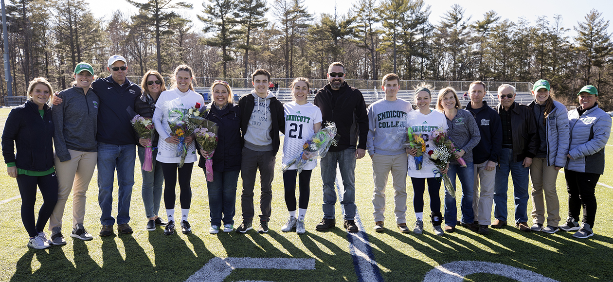 Photo of Endicott women's lacrosse seniors and their families.