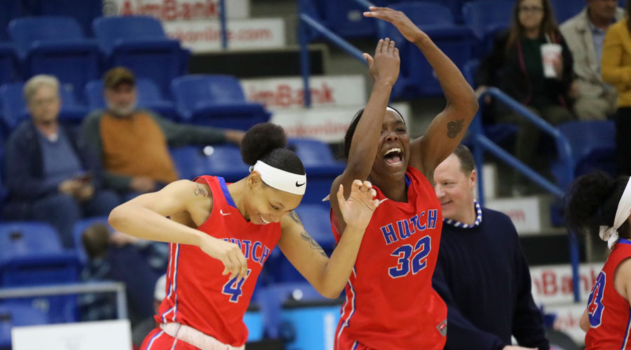 Jada Mickens (32) and Tijuana Kimbro (4) celebrate as the buzzer sounds after the Blue Dragon women defeated Odessa 66-50 on Thursday in the quarterfinals of the NJCAA Women's National Tournament in Lubbock, Texas. (Joe Morales/QuickShotz photography)