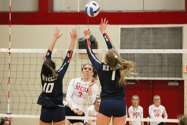Mesa's Lauren Palmer attempts a kill in Friday night's victory over the Pima Aztecs. (Photo by Aaron Webster)