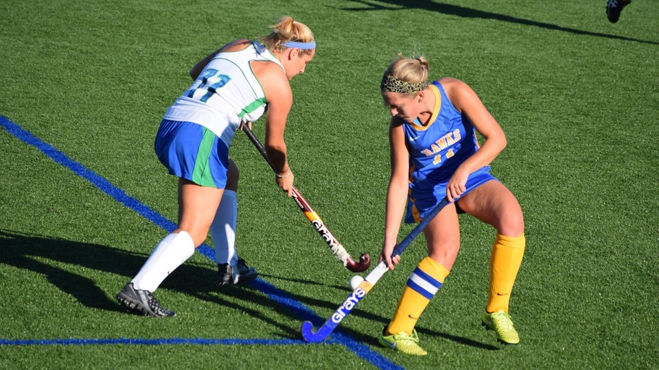 Amber Cody (No. 11) works against the Hawks.
