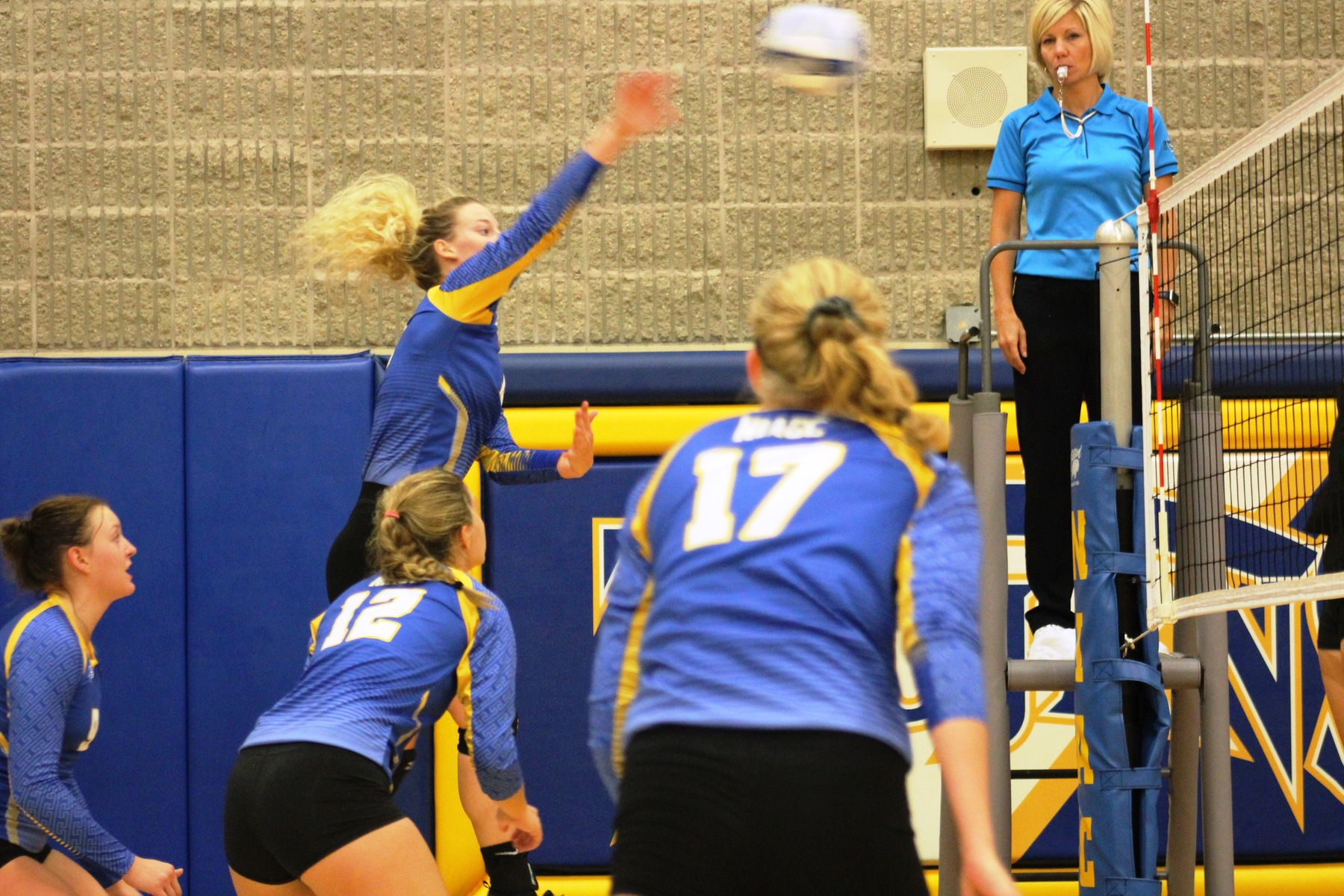 Shelby Heston puts down a kill against Ellsworth on Sunday.