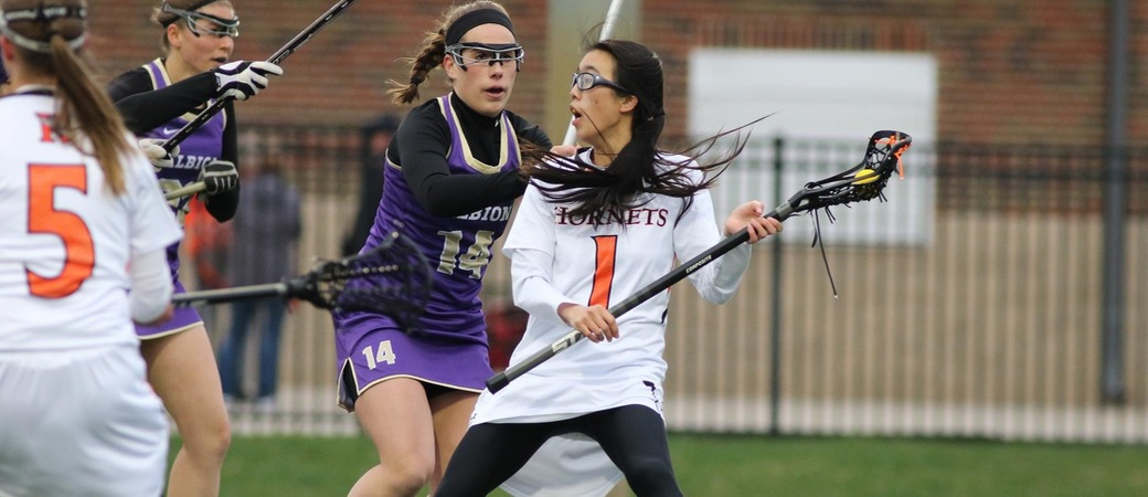 Amanda Moss playing lacrosse.