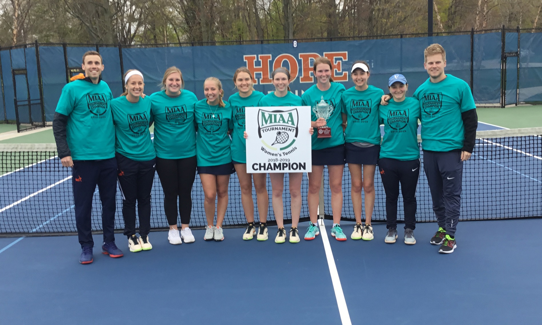 Hope women's tennis team poses with MIAA Tournament championship trophy