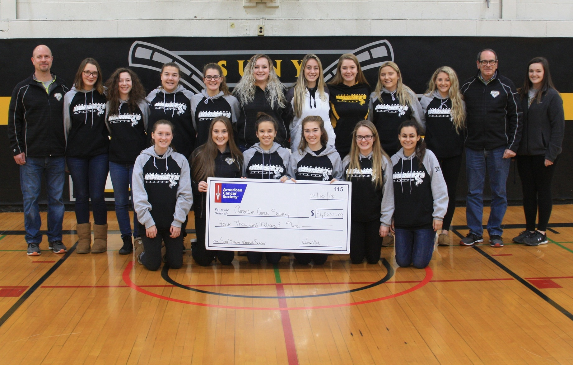 W Soccer Presents Check To ACS