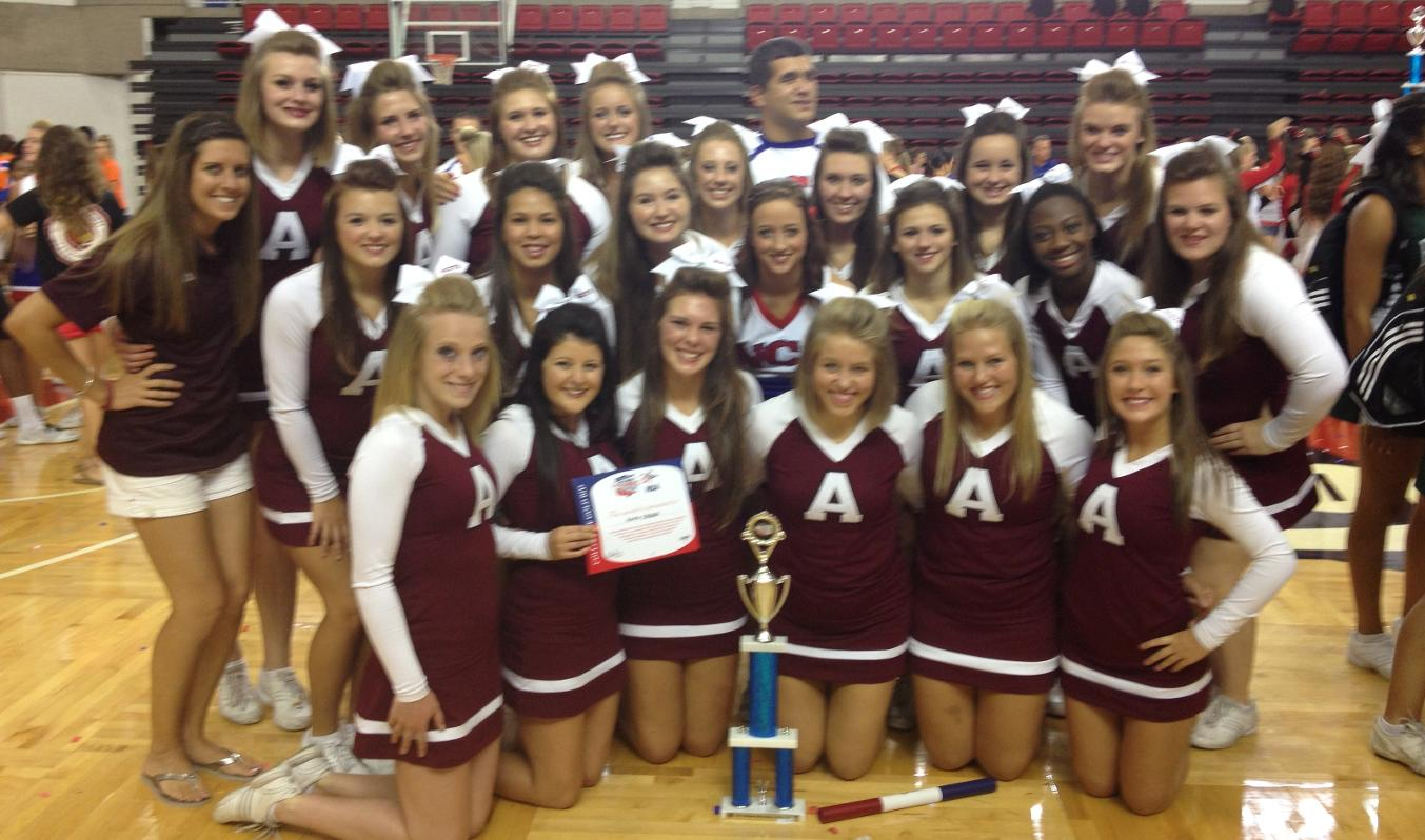 "Cheer team competed at qualifying camp in Louisville, Kentucky and earned a ""Gold Paid Bid"" to Nationals"