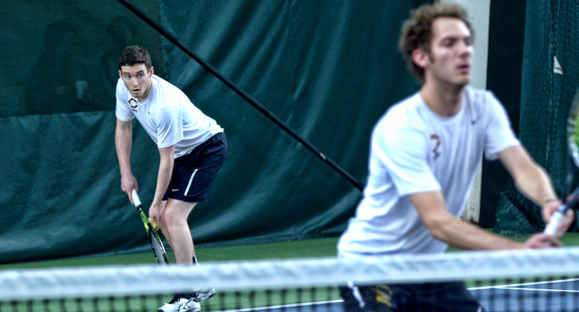 The doubles team of Erik Porter (L) and David Schneck claimed one of the two doubles wins for the Cobbers in the MIAC opener at St. John's.