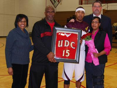 UDC A.D. Patricia Thomas and Coach Ruland are pictured with Tim Ellison and his parents Mr. & Mrs. Leon Ellison during Senior Night presentation