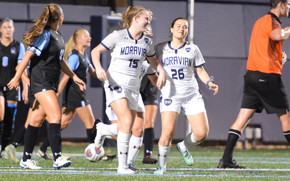 The Greyhounds celebrate senior Paige Weiss' goal in the victory over Stockton University on John Makuvek Field.