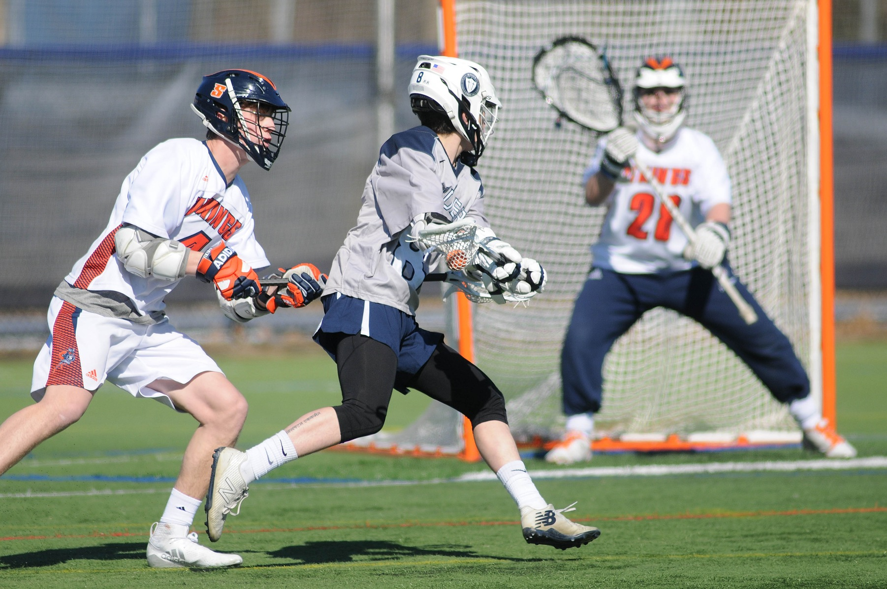 Men's Lacrosse: Raiders edge Saints, 12-11.