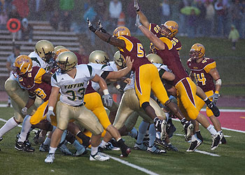 The Bulldogs try to block a Tiffin extra point attempt (Photo by Scott Whitney)