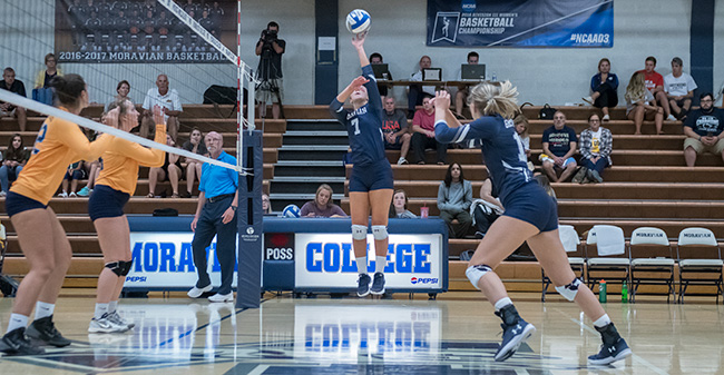 Victoria Kauffman '20 dumps a ball over the net versus Wilkes University.