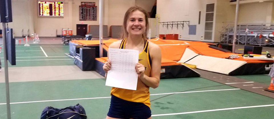 Kelsey Bowling holds her record-setting scoresheet from the pentathlon (Photo courtesy of Demetrius Bailey)