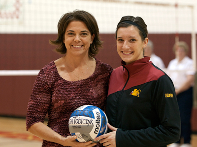 FSU head coach Tia Brandel-Wihelm presents Lisa Tobiczyk with a ceremonial ball to acknowledge her 1,000th career dig.  (Photo by Ben Amato)