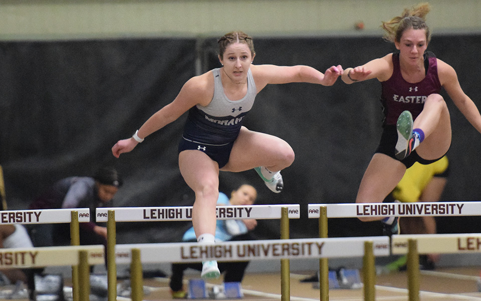 Freshman Shannon Connelly clears a hurdle during a race in the Moravian Indoor Invitational at Lehigh University's Rauch Field House.