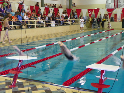 WOMEN'S SWIMMING EARNS VICTORY OVER DELHI IN DOUBLE DUAL MEET