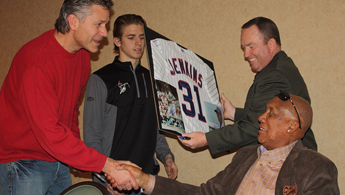 Hall of Fame Pitcher and featured guest Ferguson Jenkins autographs a jersey for Alex and Blake Benyo
