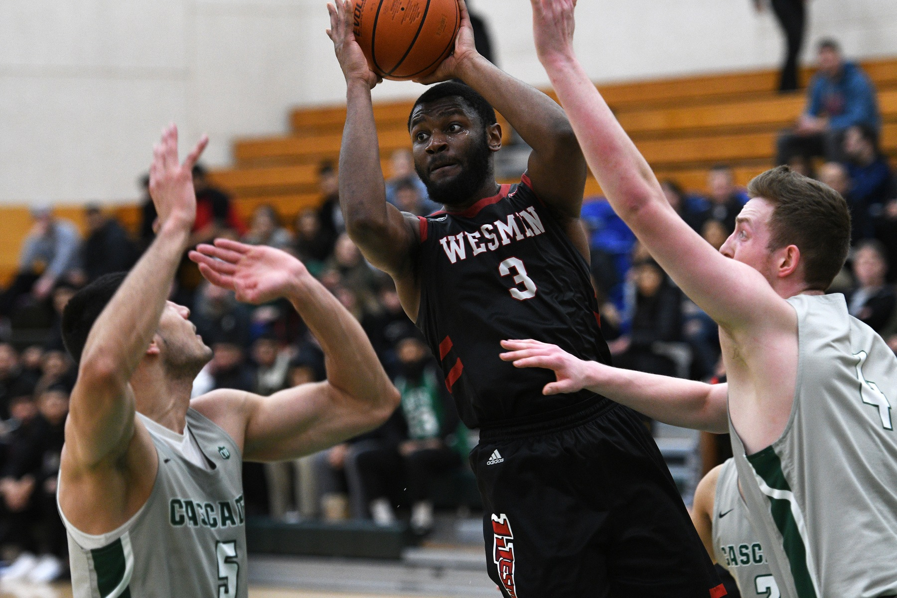 Narcisse Ambanza looks for teammates during a Canada West conference playoff game Friday, Feb. 14, 2020 in Abbotsford, B.C. (Dan Kinvig/UFV photo)