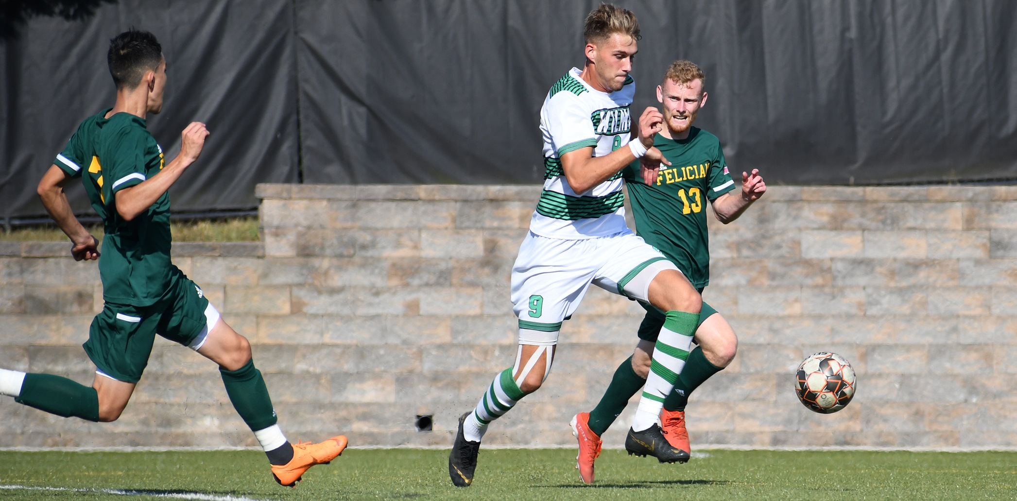 Wilmington University's player Lorne Bickley (9) controls the ball as Felician College players Dean Wright (13) and Jorge Zerna (7) follow the play during the Men's NCAA division II soccer match at the Wilmington University sports complex, Saturday September 21, 2019. Photo by Keyana Ringgold