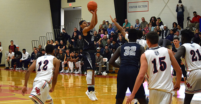 C.J. Barnes '20 attempts a three-pointer in the first half at DeSales University.