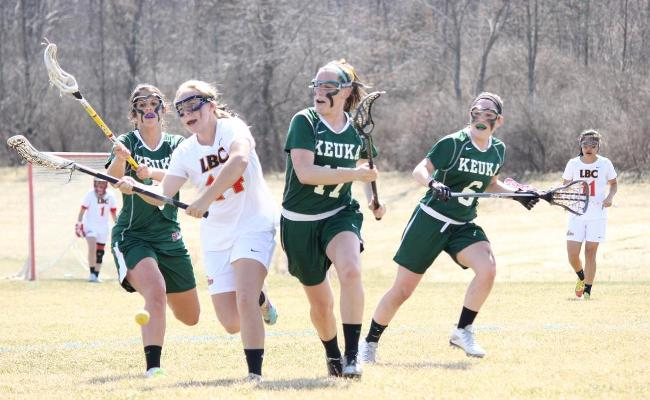 Junior Kaycee Maguire (no. 17) scored three goals with three assists as the Keuka College women's lacrosse team advanced into the NEAC championship with a 21-6 win over Cazenovia College Saturday (photo courtesy of Carly Volante, Keuka College Sports Information Department).