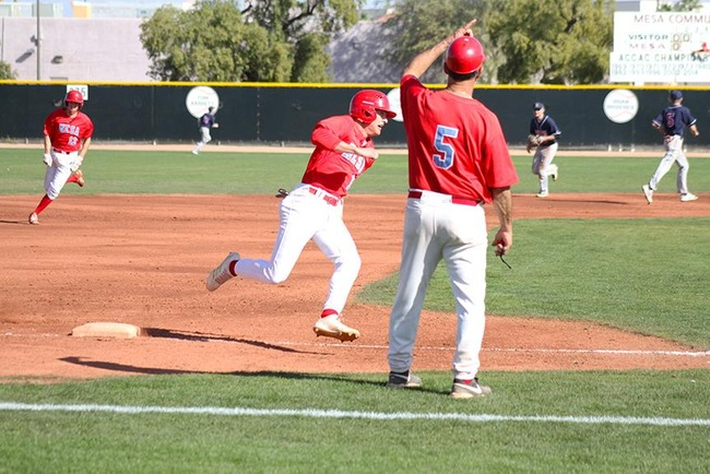 Mesa Head Coach, Tony Cirelli, sends home a couple T-Bird base-runners on a triple from Riley Peterson. (Photo by Aaron Webster)